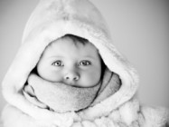 bundled up baby - black and white photo