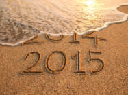 New year 2015 and old year 2014 written on the sand with wave