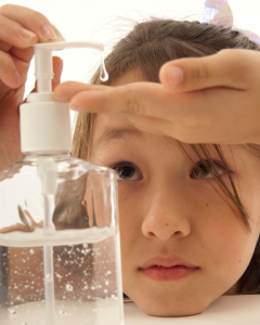 LIttle Girl Using Hand Sanitizer