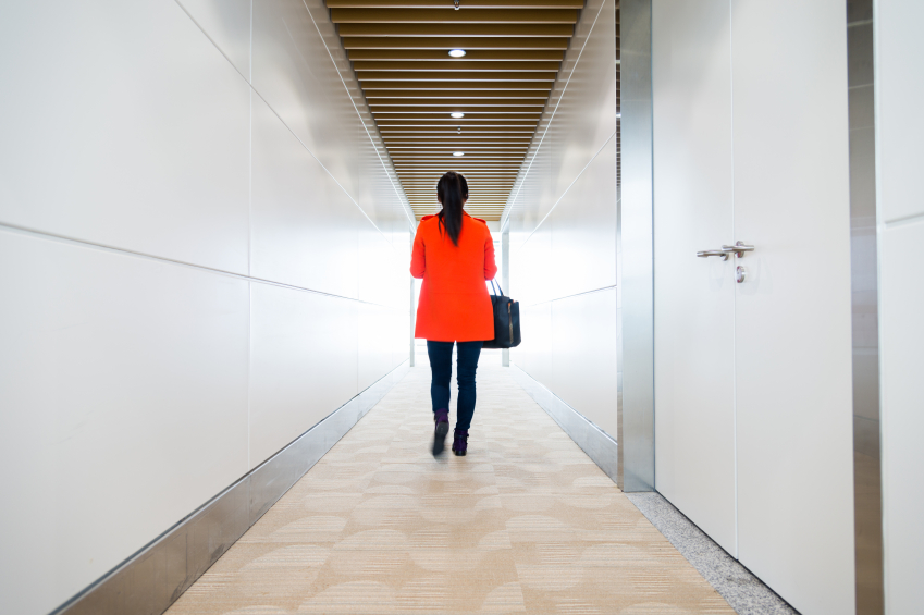 Woman walking through a hallway
