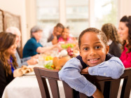 kid smiling at dinner table