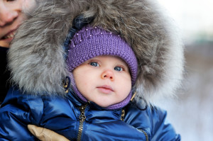 Adorable baby girl in winter clothes