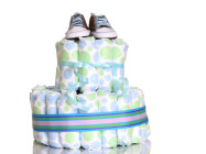 pair of tiny baby shoes on diaper pile