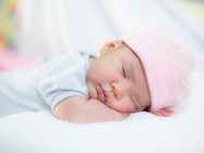 cute newborn baby with pink cap