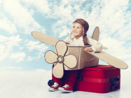 Little Child Playing Airplane Pilot, Kid Traveler on Travel Suitcase