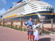 Dr. Kim with her family in front of the Disney Cruise line