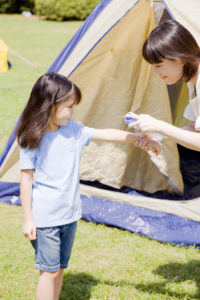 Insect repellent spray to her mother