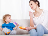 Mum and child eating a healthy snack together, horizontal