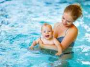 Mother and baby swim in the pool