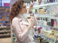 Girl choosing a perfume at store